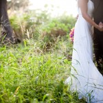 Couple holding hands at a Maui wedding by destination wedding planner, Mango Muse Events
