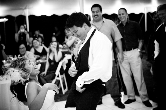 Strip tease garter toss dance at a Maui wedding by destination wedding planner, Mango Muse Events