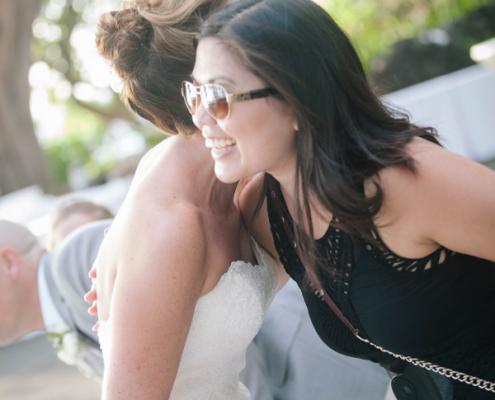 Mango Muse Events, destination wedding planner hugging happy bride