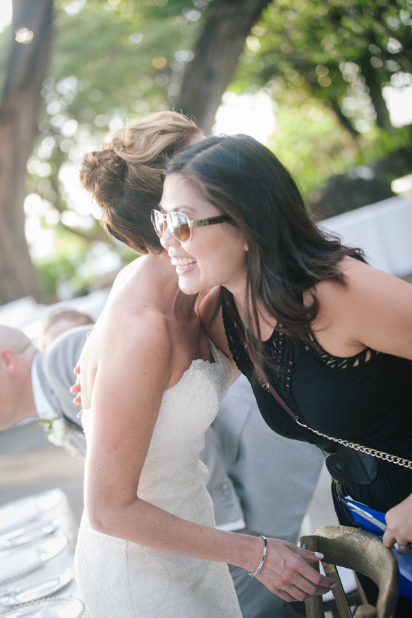 Mango Muse Events, destination wedding planner hugging happy bride at a Hawaii destination wedding