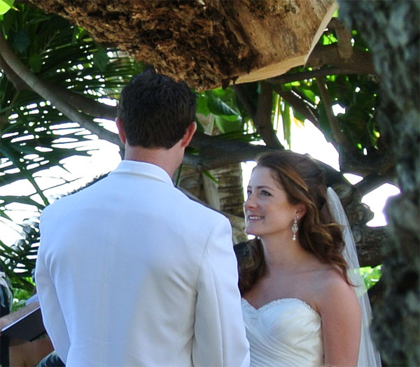 Wedding ceremony under the trees at a Hawaii destination wedding by Destination wedding planner, Mango Muse Events