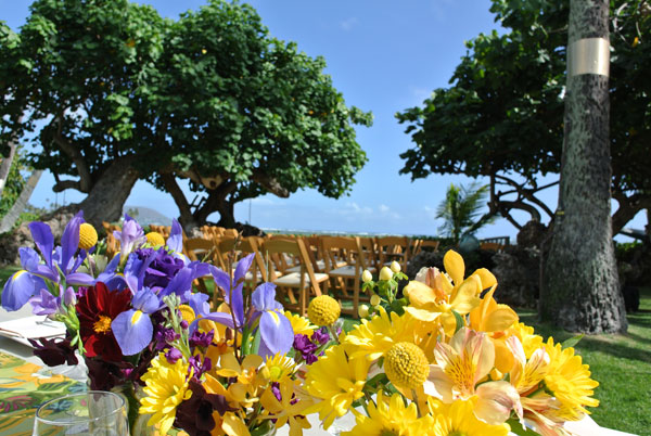 Yellow and purple flowers at a Hawaii destination wedding by Destination wedding planner, Mango Muse Events