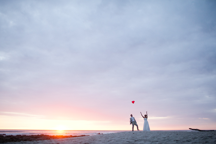 Wedding couple on a beach at sunset Costa Rica destination wedding by Destination wedding planner, Mango Muse Events