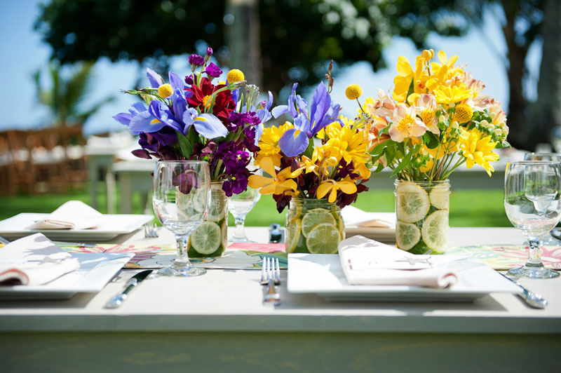 Yellow and purple mason joar wedding centerpieces for a Hawaii destination wedding on Style Me Pretty by Destination wedding planner, Mango Muse Events