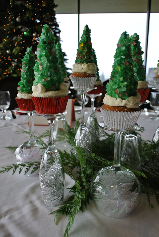 Christmas tree cupcakes and wine glass stands as a Holiday party centerpiece idea by Destination wedding