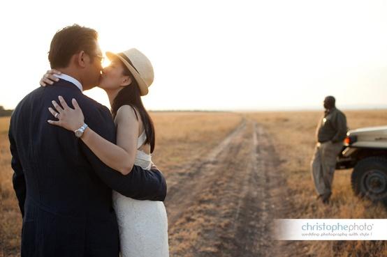 Wedding couple kissing on Safari at a Kenya destination wedding shared by Destination wedding planner, Mango Muse Events