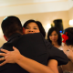 Wedding couple hugging wedding guests at a destination wedding in lieu of a wedding reception line