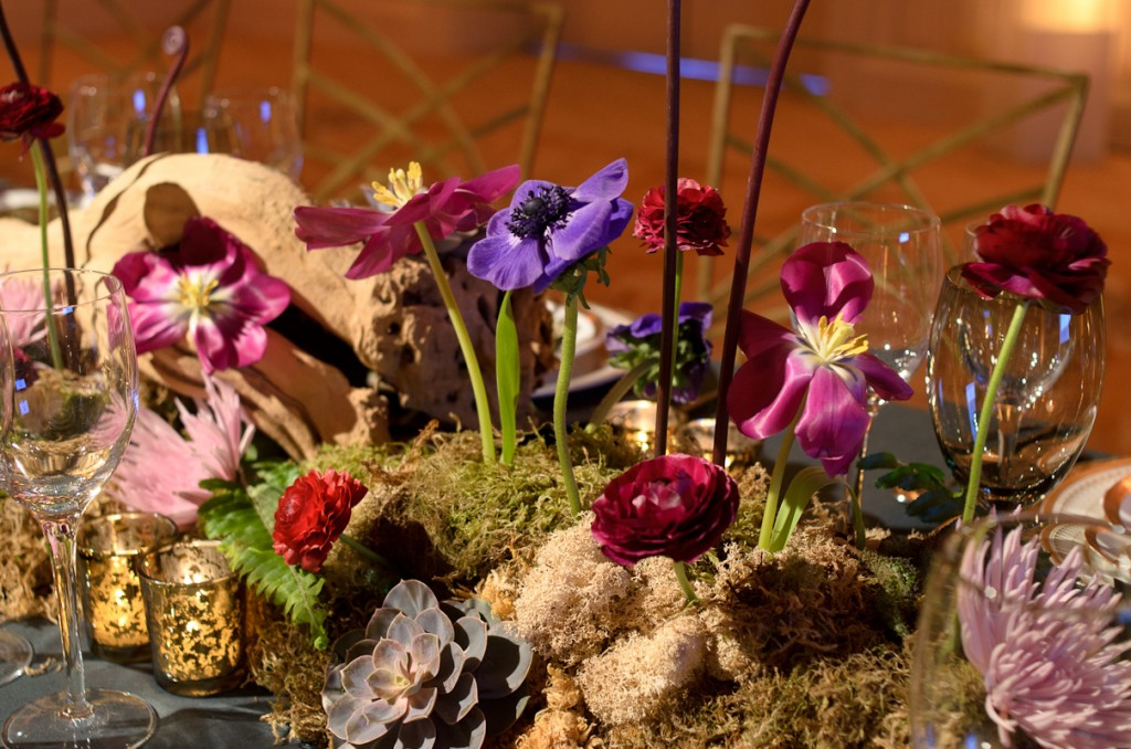 Moss succulents and anemones in the centerpiece for a fairytale wedding table design created for the Beyond Blu Bungalow Venue Tours by Destination wedding planner Mango Muse Events