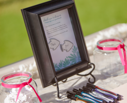 Wedding guestbook where guests sign paper fish for a Hawaii destination wedding by Destination wedding planner Mango Muse Events