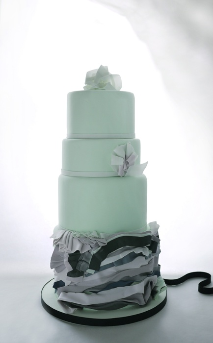 Ribboned mint colored wedding cake designs by Charm City Cakes and shared by Destination wedding planner Mango Muse Events