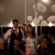 Wedding couple toasting at a Hawaii destination wedding