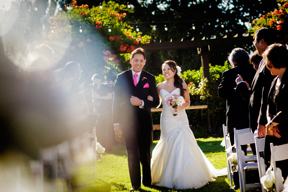 Father daughter moment walking down the aisle of a Sonoma destination wedding by Destination wedding planner Mango Muse Events