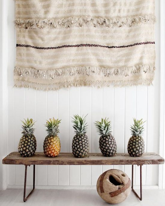 Pineapples on a rustic wood bench