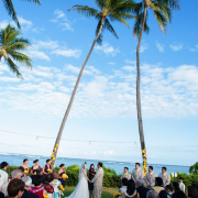 Outdoor wedding ceremony at a Hawaii holiday wedding by Destination wedding planner Mango Muse Events