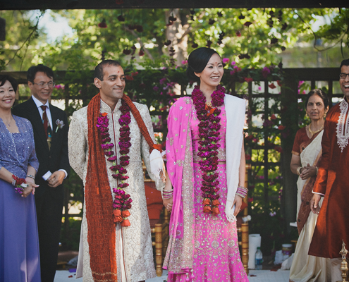 Newlywed couple at the end of a Hindu wedding ceremony for a multi cultural wedding by Destination wedding planner Mango Muse Events