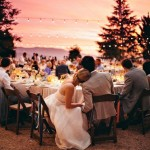 Wedding couple leaning on each other and enjoying a sunset at their wedding reception shared by Destination wedding planner Mango Muse Events