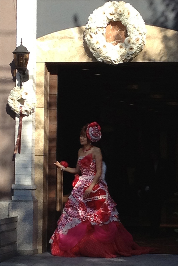 Bride in a red western wedding dress for a Japanese wedding shared by Destination wedding planner Mango Muse Events