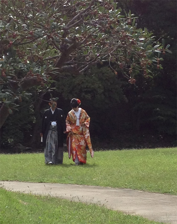 Bride and groom dressed in traditional kimonos for a Japanese wedding shared by Destination wedding planner Mango Muse Events