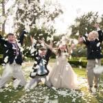 Kids throwing flower petals at a wedding