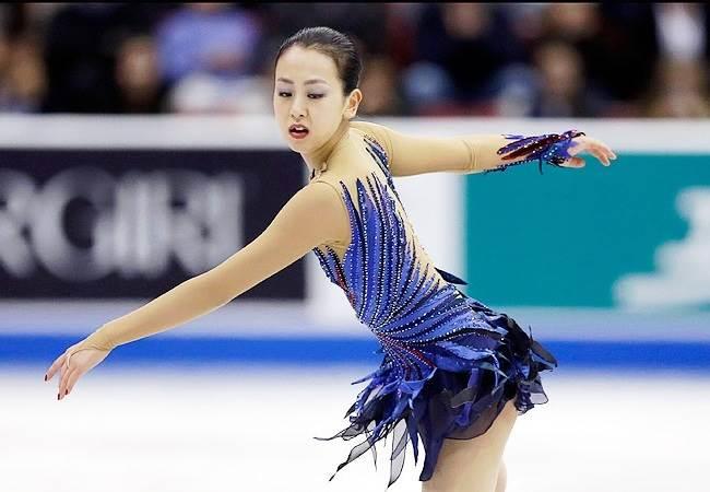 Mao Asada skating on the ice at the 2014 Winter Olympics