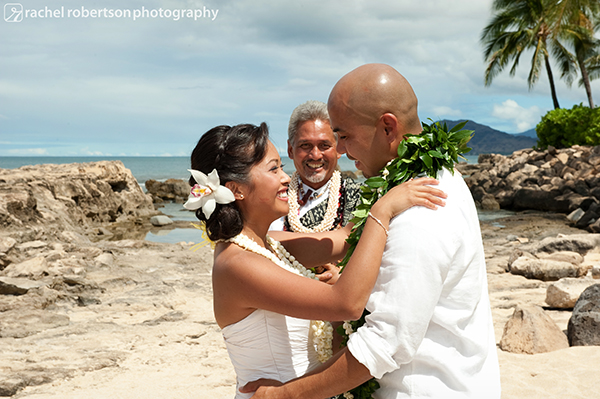 Ceremony officiant and newlyweds at destination wedding in Hawaii by destination wedding planner Jamie Chang of Mango Muse Events.