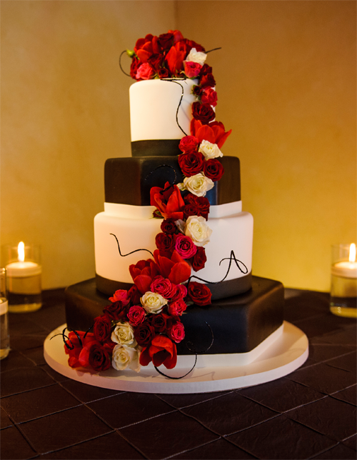 A mixed shape cake with no cake stand at a wedding by destination wedding planner Jamie Chang of Mango Muse Events.