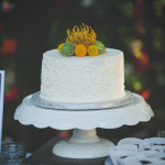 White pedestal wedding cake stand at a destination wedding by destination wedding planner Jamie Chang of Mango Muse Events.