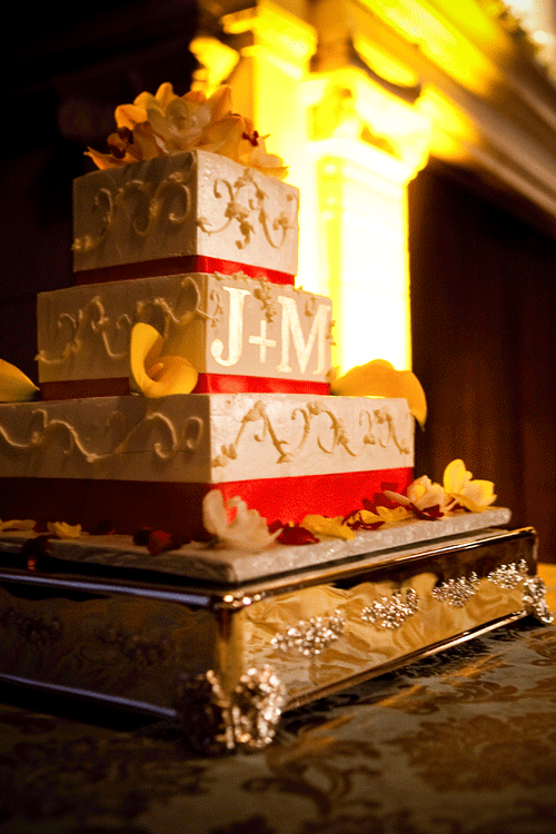 A base cake stand with a 3 tier square cake at a wedding by destination wedding planner Jamie Chang of Mango Muse Events.