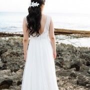 Bride with floral hairpiece at her wedding in Hawaii by Jamie Chang destination wedding planner of Mango Muse Events.