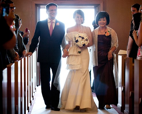 Parents walking bride down aisle at wedding designed by destination wedding planner Jamie Chang of Mango Muse Events.