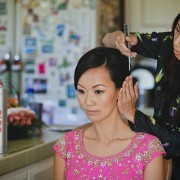 Bride getting her hair ready for wedding planned by destination wedding planner Jamie Chang of Mango Muse Events.