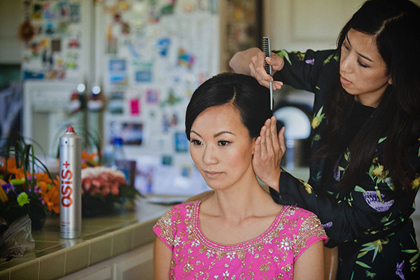 Bride getting her wedding hairstyle done for a wedding planned by destination wedding planner Jamie Chang of Mango Muse Events.
