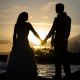 A couple enjoying the sunset at their 4th of July wedding in Hawaii by Destination wedding planner Mango Muse Events