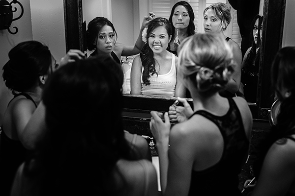 Bride and bridesmaids getting hair and makeup done for a  Sonoma wedding by destination wedding planner Jamie Chang of Mango Muse Events.