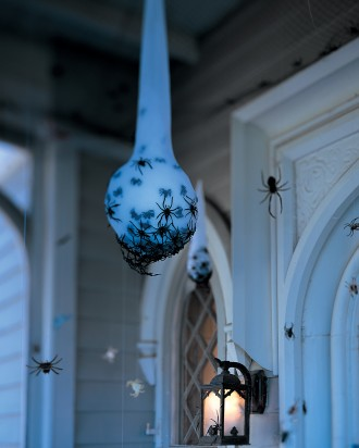 Fake spider egg sac outdoor decoration for Halloween.