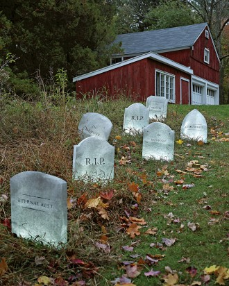 Fake tombstones decoration in front yard for Halloween.