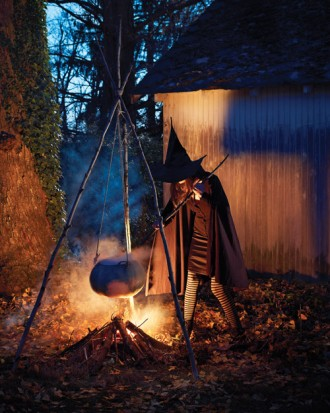 Outdoor witch's cauldron Halloween decor.