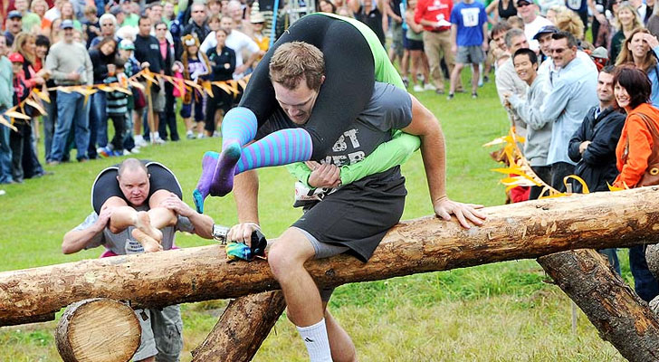 Man carrying his wife in the North American Wife Carrying Championships.