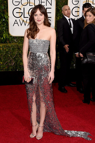 Dakota Johnson wears a metallic Chanel gown on the red carpet of the 2015 Golden Globes wedding inspiration by destination wedding planner, Mango Muse Events