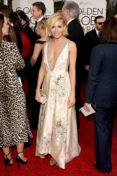 Sienna Miller wears a boho Miu Miu gown on the red carpet of the 2015 Golden Globes wedding inspiration by destination wedding planner, Mango Muse Events