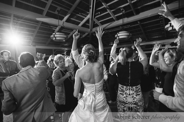Bride and wedding guests dancing at destination wedding in Carmel. Event design by Jamie Chang of Mango Muse Events.