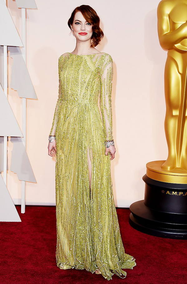 Emma Stone wears an Elie Saab gold beaded gown for 2015 Oscars wedding inspiration by destination wedding planner Mango Muse Events
