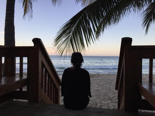 Jamie Chang destination wedding planner enjoying the sunset on St. Croix, a Caribbean destination wedding location.