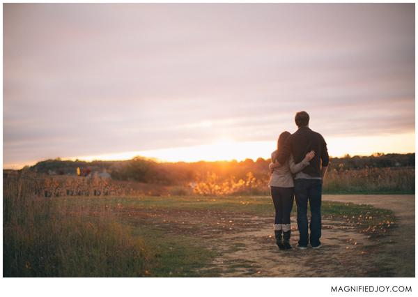 Engaged couple taking sunrise photos for their engagement photo shoot.