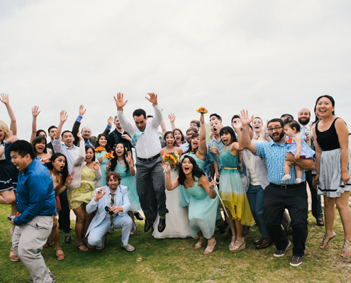 Group photos and family portraits taken at a Hawaii destination wedding by destination wedding planner Mango Muse Events