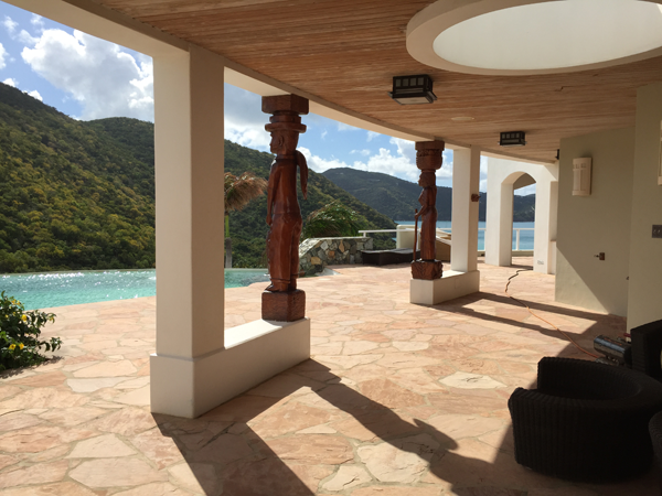 Outdoor pool and lounge area of the Jost House villa perfect for a Guana destination wedding in the Caribbean by Jamie Chang destination wedding planner of Mango Muse Events.