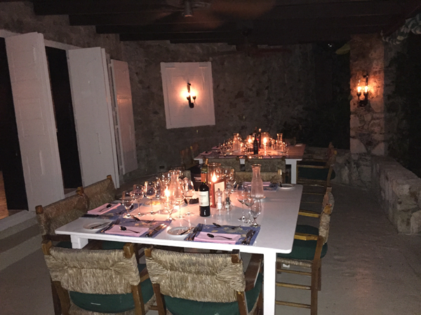 Patio dining at the main house for a Guana destination wedding in the Caribbean by Jamie Chang destination wedding planner of Mango Muse Events.