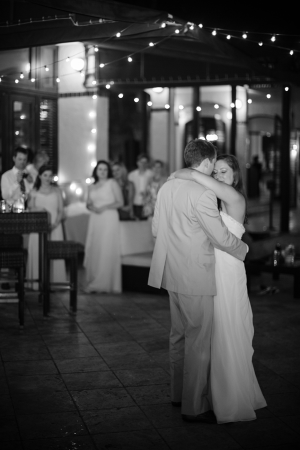 Bride and Groom dance to their first dance song at a destination wedding in the Caribbean planned by destination wedding planner Jamie Chang of Mango Muse Events.
