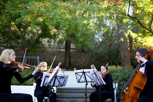String Quartet performing at a wedding at the Livermore Winery by Jamie Chang destination wedding planner of Mango Muse Events.