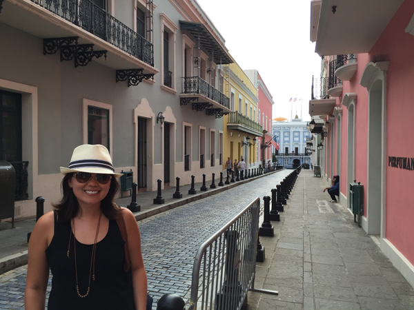 Jamie Chang destination wedding planner of Mango Muse Events, standing in the streets of Puerto Rico.